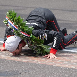 Will Power kisses the bricks after winning the 2018 Indianapolis 500